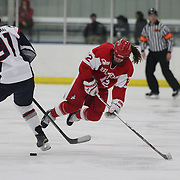 Victoria Bach, Boston University, is tripped by Madison Badeau, UConn, during the UConn Vs Boston University, Women's Ice Hockey game at Mark Edward Freitas Ice Forum, Storrs, Connecticut, USA. 5th December 2015. Photo Tim Clayton