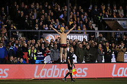 20 February 2017 - The FA Cup - (5th Round) - Sutton United v Arsenal - A Sutton fan dressed in nothing but 'kiss me' boxer shorts and a Giraffe hat stand on the advertising boards in front of the main stand - Photo: Marc Atkins / Offside.