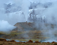 Steam Blowing from a Concrete Cistern Covering a Hot Spring Providing Hot Water to Hotel Geysir. Haukadalur / Geysir region in Iceland. Image taken with a Nikon Df camera and 70-200 mm f/4 VR lens (ISO 200, 160 mm, f/8, 1/640 sec).