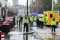 © Licensed to London News Pictures. 01/10/2019. London, UK. The scene in Westminster after Police detained a man who poured petrol on himself and attempted to set himself on fire outside the Houses of Parliament at Carriage Gate. Photo credit: George Cracknell Wright/LNP