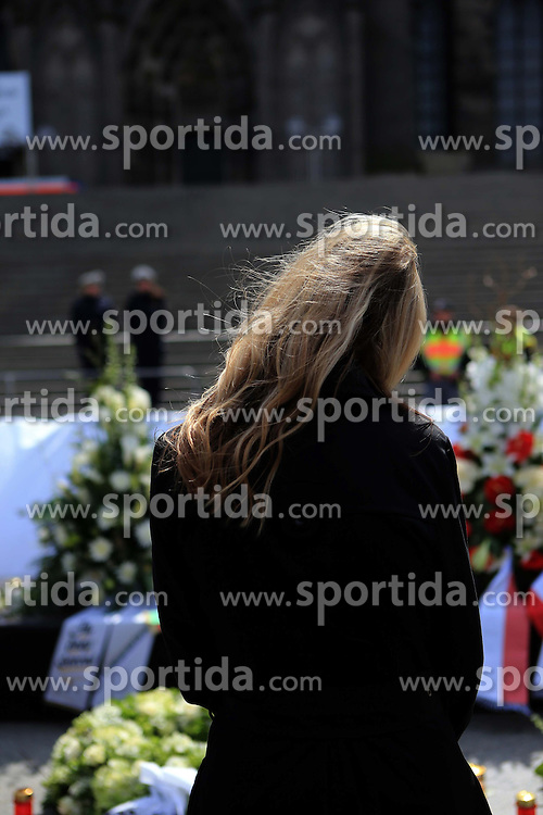 A woman mourns for the victims of the Germanwings plane crash at the Cologne Cathedral in Cologne, Germany, April 17, 2015. About 1,500 people are expected to attend the memorial service for the victims of the Germanwings plane crash held at the Cologne Cathedral on Friday. EXPA Pictures &copy; 2015, PhotoCredit: EXPA/ Photoshot/ Luo Huanhuan<br /> <br /> *****ATTENTION - for AUT, SLO, CRO, SRB, BIH, MAZ only*****