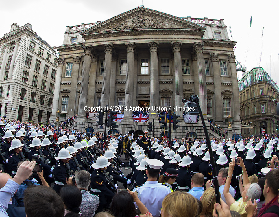 Image ©Licensed to i-Images Picture Agency. 25/07/2014. London, United Kingdom. Royal Marines March through the City of London. . Picture by Anthony Upton / i-Images<br /> Royal Marines exercise their traditional right to march through the City of London, \'with Bayonets Fixed and Drums Beating\', as part of the 350th Anniversary Celebrations.