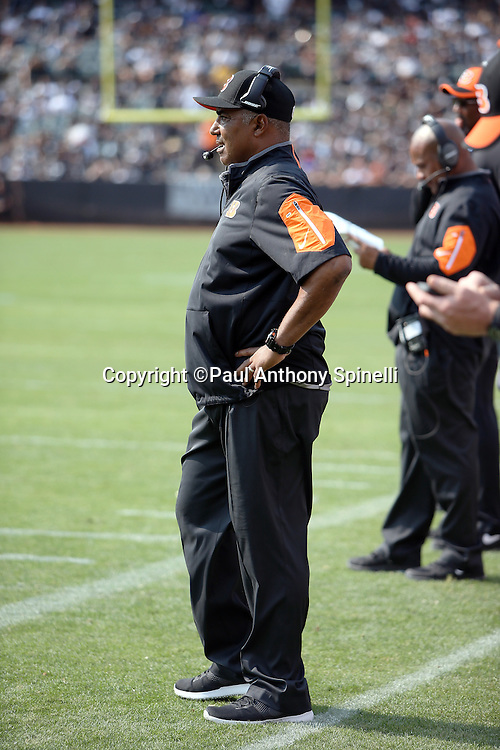 Cincinnati Bengals head coach Marvin Lewis looks on from the sideline during the 2015 NFL week 1 regular season football game against the Oakland Raiders on Sunday, Sept. 13, 2015 in Oakland, Calif. The Bengals won the game 33-13. (©Paul Anthony Spinelli)