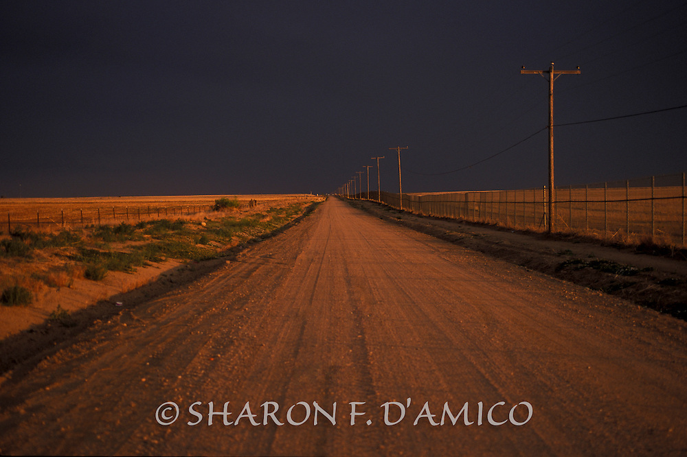 DIRT ROAD AND STORMY SKY 70809.JPG
