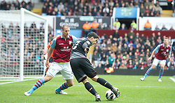 BIRMINGHAM, ENGLAND - Easter Sunday, March 31, 2013: Liverpool's Luis Alberto Suarez Diaz in action against Aston Villa's Ron Vlaar during the Premiership match at Villa Park. (Pic by David Rawcliffe/Propaganda)