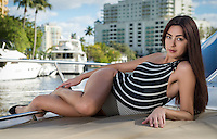 Young and sensual caucasian woman relaxing in a bock deck in Fort Lauderdale, Florida.