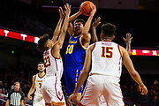 South Dakota State Jackrabbits forward David Wingett (50) shoots the ball over Southern California Trojans forward Max Agbonkpolo (23) during the first half of an NCAA basketball game, Tuesday, Nov. 12, 2019, in Los Angeles. USC defeated South Dakota State 84-66. (Brandon Sloter/Image of Sport)