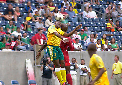17 July 2005:   Lucas Thwala of South Africa goes up for a header during Gold Cup quarterfinal loss to Panama. Reliant Stadium, Houston, TX.
