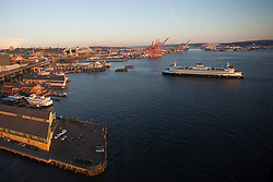 United States, Washington, Seattle,waterfront, ferry and Port of Seattle with cranes