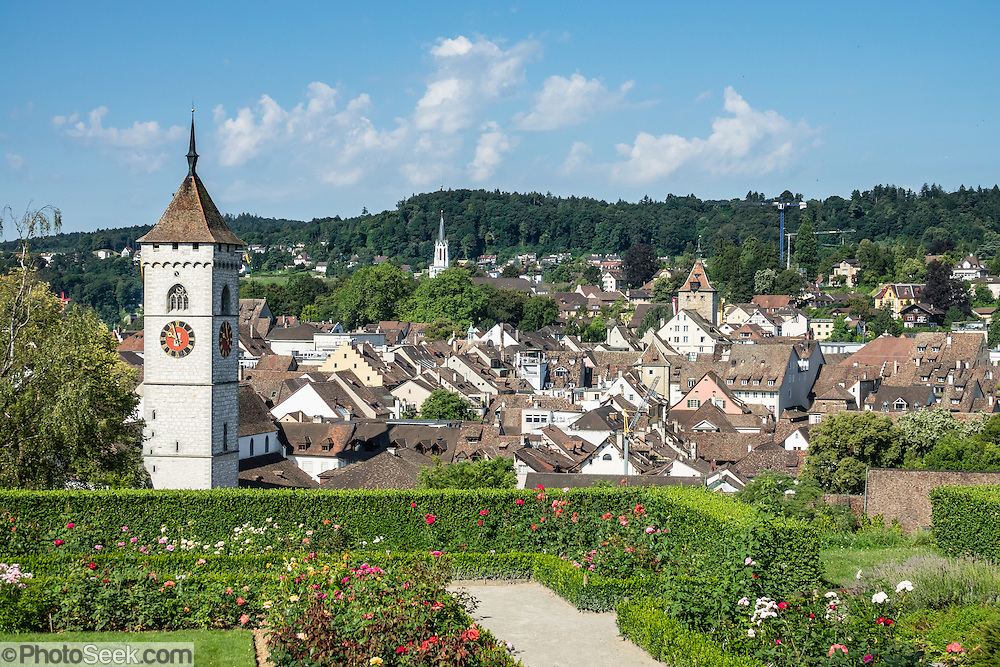 Rosengarten, the rose garden, is designed in French Renaissance style, next to the entrance of the Munot fortress in Schaffhausen, Switzerland, Europe. Beyond is the steeple of St. Johann Church.