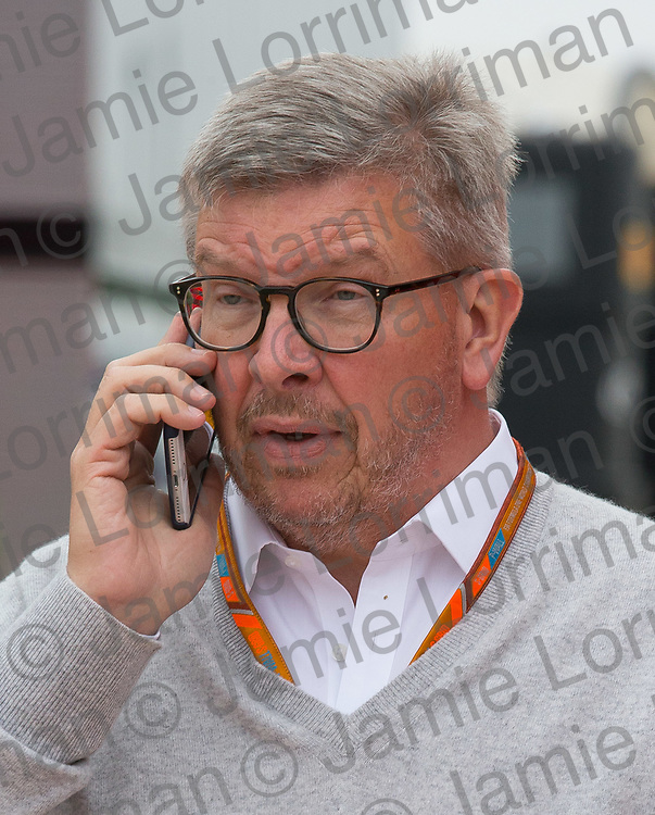The 2017 Formula 1 Rolex British Grand Prix at Silverstone Circuit, Northamptonshire.<br /> <br /> Pictured: Ross Brawn on the phone as he walks through the paddock at the British F1 Grand Prix.<br /> <br /> Jamie Lorriman<br /> mail@jamielorriman.co.uk<br /> www.jamielorriman.co.uk<br /> +44 7718 900288