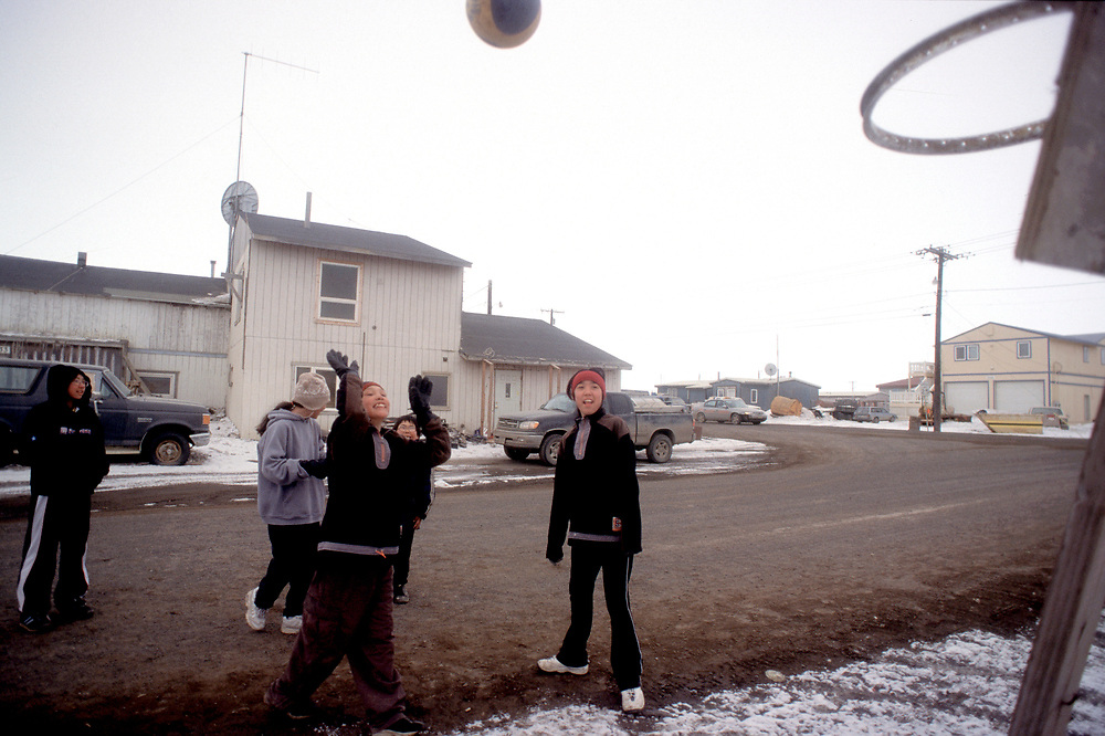 Girls play basketball on the street enjoying the nice weather.<br /> <br /> May 14, 19:45