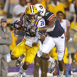 Sep 21, 2013; Baton Rouge, LA, USA; LSU Tigers cornerback Jalen Mills (28) is tackled by Auburn Tigers wide receiver Sammie Coates (18) after intercepting the ball during the second half of a game at Tiger Stadium. LSU defeated Auburn 35-21. Mandatory Credit: Derick E. Hingle-USA TODAY Sports