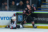 KELOWNA, BC - FEBRUARY 17: Elias Carmichael #14 of the Kelowna Rockets falls to the ice after a check by Kyle Olson #16 of the Calgary Hitmen at Prospera Place on February 17, 2020 in Kelowna, Canada. (Photo by Marissa Baecker/Shoot the Breeze)