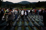 Victims of the Srebrenica genocide laid out at the Potocari memorial. Searching for family members.