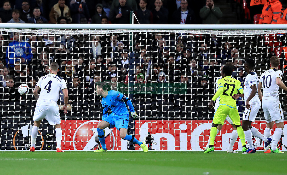Tottenham Hotspur's Harry Kane (right) scores an own goal during the match