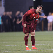 Cristiano Ronaldo, Portugal, feels his knee after a challenge by David Meyler, Ireland, during the Portugal V Ireland International Friendly match in preparation for the 2014 FIFA World Cup in Brazil. MetLife Stadium, Rutherford, New Jersey, USA. 10th June 2014. Photo Tim Clayton