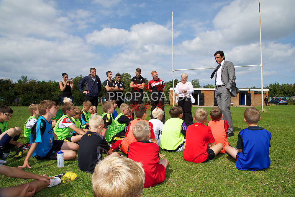 RHYL, WALES - Tuesday, August 20, 2013: Wales manager Chris Coleman speaks to children at the Ysgol Tir Morfa. (Pic by David Rawcliffe/Propaganda)