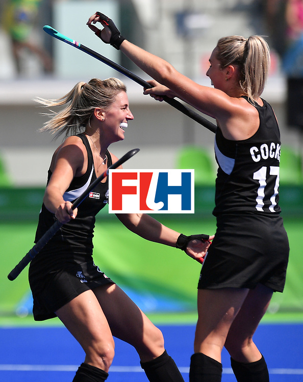 New Zealand's Gemma Flynn (L) celebrates after scoring her team's third goal during the the women's quarterfinal field hockey New Zealand vs Australia match of the Rio 2016 Olympics Games at the Olympic Hockey Centre in Rio de Janeiro on August 15, 2016. / AFP / Carl DE SOUZA        (Photo credit should read CARL DE SOUZA/AFP/Getty Images)