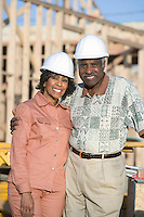 Middle-aged couple at construction site, portrait