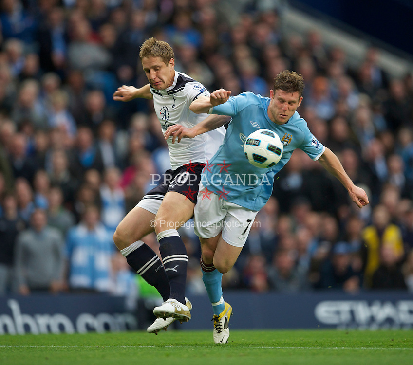 MANCHESTER, ENGLAND - Monday, May 10, 2011: Manchester City's James Milner and Tottenham Hotspur's captain Michael Dawson during the Premiership match at the City of Manchester Stadium. (Photo by David Rawcliffe/Propaganda)