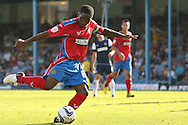 Picture by David Horn/Focus Images Ltd +44 7545 970036.08/09/2012.Abu Ogogo, Captain of Dagenham and Redbridge takes a shot during the npower League 2 match at Roots Hall, Southend.