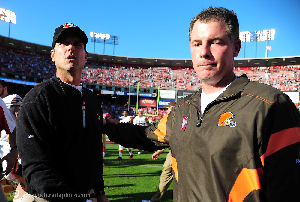 October 30, 2011; San Francisco, CA, USA; San Francisco 49ers head coach Jim Harbaugh (left) shakes hands with Cleveland Browns head coach Pat Shurmur (right) after the game at Candlestick Park. The 49ers defeated the Browns 20-10.