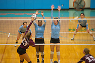 Tufts outside hitter Esme Nulan, A16, left, and middle hitter Elizabeth Ahrens, A17, block a Springfield College player on Sep. 9, 2015. (Evan Sayles/The Tufts Daily Archive)