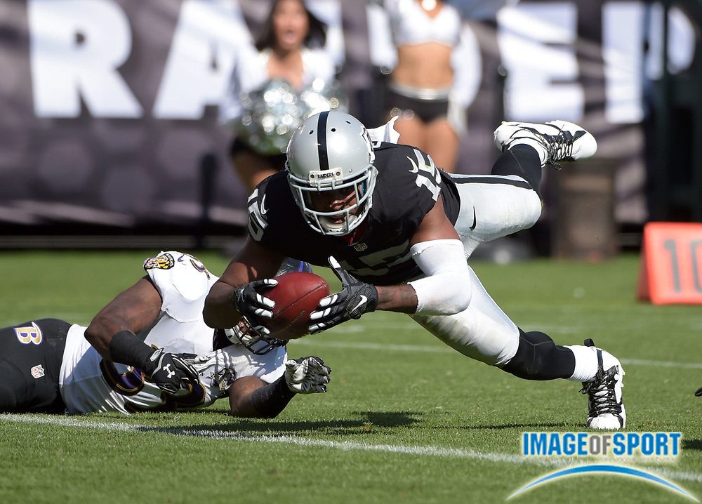 Sep 20, 2015; Oakland, CA, USA; Oakland Raiders receiver Michael Crabtree (15) scores on a 29-yard touchdown reception in the third quarter against the Baltimore Ravens as  at O.co Coliseum.  The Raiders defeated the Ravens 37-33.