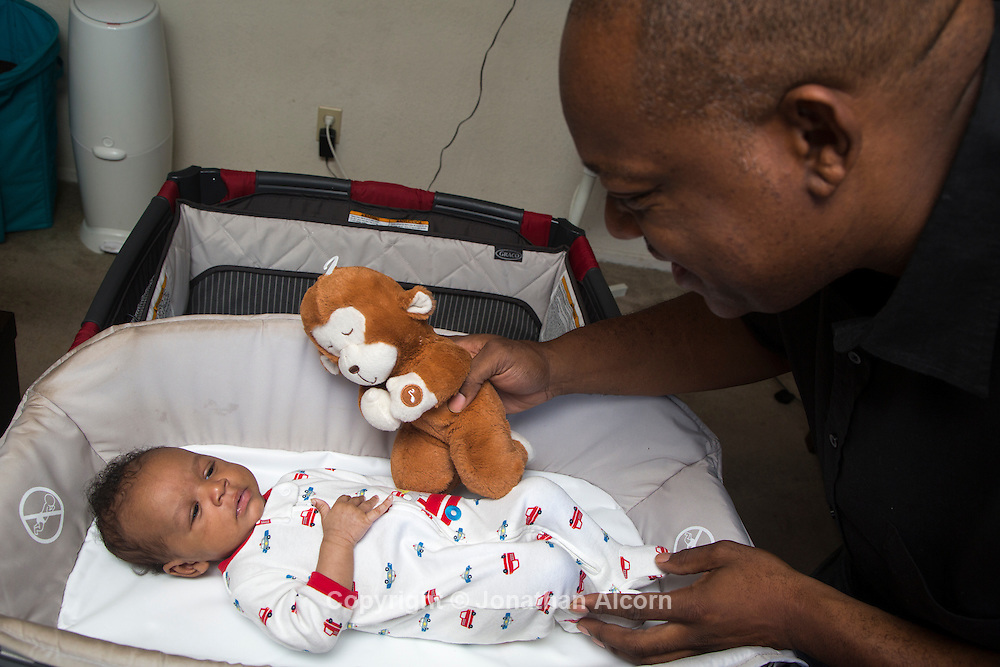 Lamar Sally and his baby Lamar Jr. pose for a photograph at his home in Los Angeles on September 23, 2014. Sally, the estranged husband of Sherri Shepherd, is the parent along with Shepherd of the baby boy that was born via surrogate.  photo by Jonathan Alcorn for MailOnline