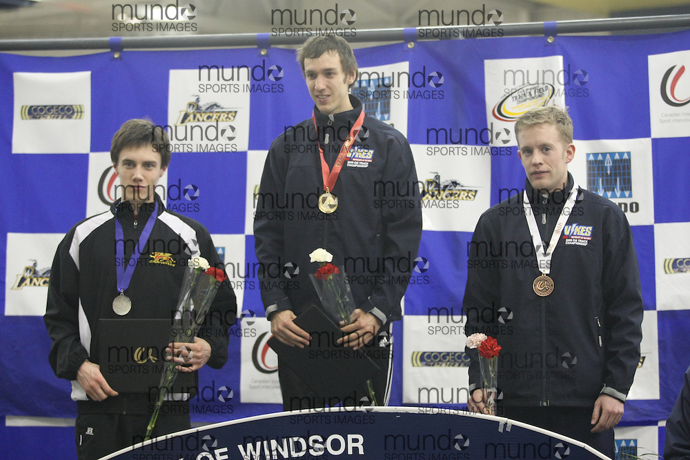 (Windsor, ON---14/03/2009) Medalists in the men's 1500m at the 2009 CIS Track and Field Championships. Geoff Martinson of the University of Victoria (middle) won the race in 3:47.84,  Kyle Boorsma (right) of the University of Guelph won the silver medal in 3:50.59, and Logan Burke of the University of Victoria (left) was third in 3:50.95. Photo copyright Sean Burges Mundo Sport Images, 2009.