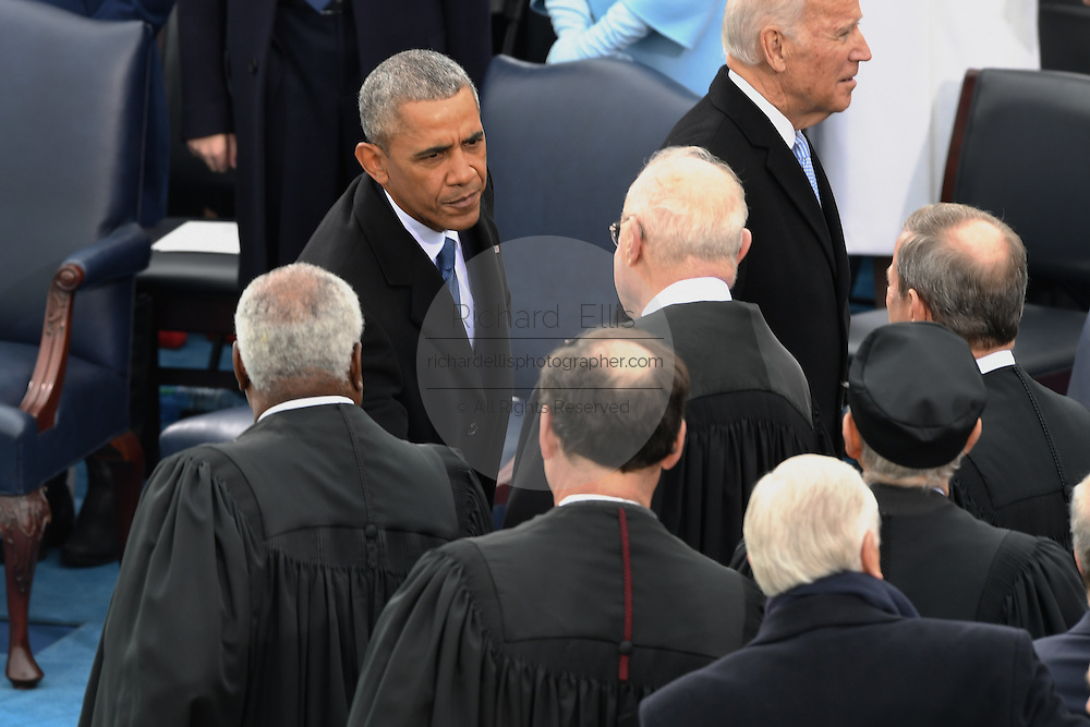President Barack Obama greets justices of the Supreme Court after he arrived for the President Inaugural Ceremony on Capitol Hill January 20, 2017 in Washington, DC. Donald Trump became the 45th President of the United States in the ceremony.