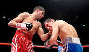A battered and bloody Marco Antonio Barrera bleeds heavily as Amir Khan lands a left hook during the WBA and WBO Inter-Continental Lightweight title fight between Amir Khan and Marc Antonio Barrera at the MEN Arena on March 14, 2009 in Manchester, England.
