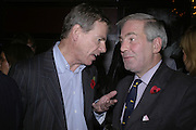 Jeremy Clarke and Russell Bryant, Drinks party to launch a new Thomas Pink shirt called The Mogul which has a pocket which houses one's cigar. Hostyed by the Spectator and Thomas Pink. Floridita. Wardour St. London. 1 November 2006. -DO NOT ARCHIVE-© Copyright Photograph by Dafydd Jones 66 Stockwell Park Rd. London SW9 0DA Tel 020 7733 0108 www.dafjones.com