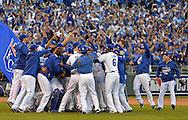 Oct 15, 2014; Kansas City, MO, USA; Kansas City Royals players celebrate on the field after game four of the 2014 ALCS playoff baseball game against the Baltimore Orioles at Kauffman Stadium. The Royals swept the Orioles to advance to the World Series. Mandatory Credit: Peter G. Aiken-USA TODAY Sports