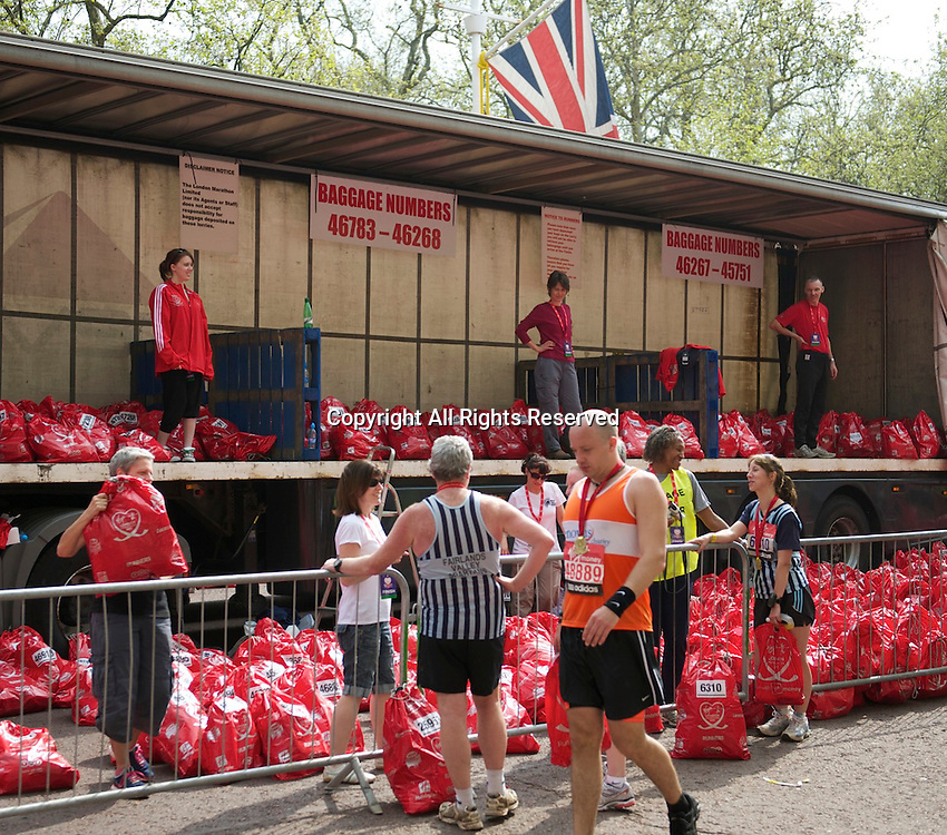 17.4.2011. Virgin London Marathon 2011. Runners pick up there bags   at the finish line of The Virgin London Marathon at The Mall, London ,England