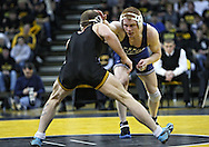 January 29, 2010: Penn State's Cyler Sanderson holds off Iowa's Jake Kerr in the 157-pound bout at Carver-Hawkeye Arena in Iowa City, Iowa on January 29, 2010. Kerr won the match 4-2 and Iowa defeated Penn State 29-6.