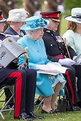 ALREWAS- UK - 17th May-2016: HM The Queen, Colonel-in-Chief, The Duke of Lancaster's Regiment, unveils a memorial to the fallen at the National Memorial Arboretum, Staffordshire.<br /> The Queen unveils a commemorative plaque during the Service of Dedication, and lays a wreath at the new memorial.<br /> Photograph by Ian Jones