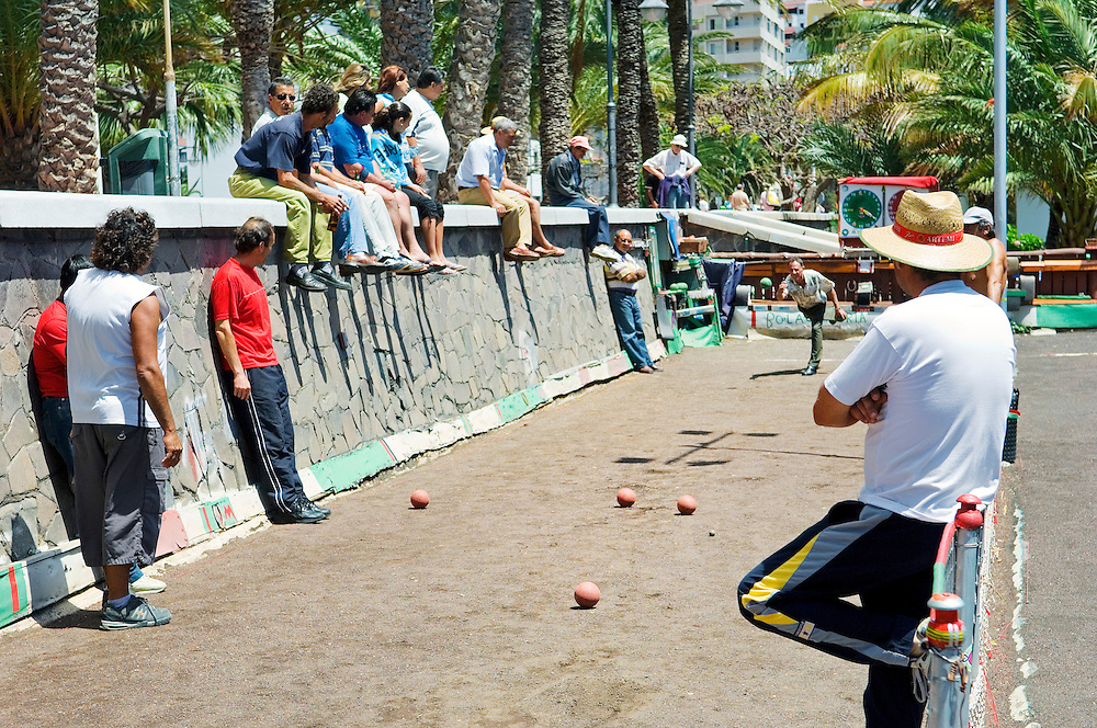 La Gomera, Canary Islands. Bowling alley on the waterfront of San Sebastian. La Gomera playing La Palma. Men playing bolas