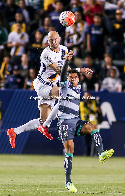 Los Angeles Galaxy's defender Jelle Van Damme and Santos Laguna's forward Javier Orozco battle for a head ball during the second half of a CONCACAF Champions League quarter final game in Carson, Calif., Wednesday, Feb. 24, 2016. The game ended in a 0-0 draw. (AP Photo/Ringo H.W. Chiu)