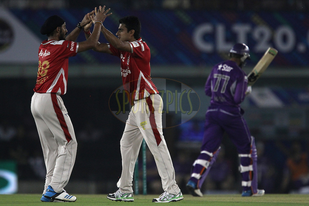 Karanveer SINGH of the Kings XI Punjab and Anureet SINGH of the Kings XI Punjab celebrate the wicket of Shoaib MALIK of the Hobart Hurricanes  during match 2 of the Oppo Champions League Twenty20 between the Kings XI Punjab and the Hobart Hurricanes held at the Punjab Cricket Association Stadium, Mohali, India on the 18th September 2014<br /> <br /> Photo by:  Ron Gaunt / Sportzpics/ CLT20<br /> <br /> <br /> Image use is subject to the terms and conditions as laid out by the BCCI/ CLT20.  The terms and conditions can be downloaded here:<br /> <br /> http://sportzpics.photoshelter.com/gallery/CLT20-Image-Terms-and-Conditions-2014/G0000IfNJn535VPU/C0000QhhKadWcjYs