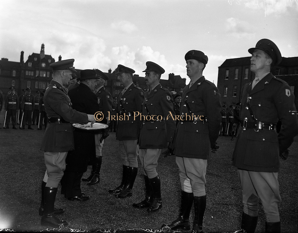 11/04/1960<br /> 04/11/1960<br /> 11 April 1960<br /> The United Nations Medal was presented to 47 Officers of the Irish Army who served in U.N.O. forces in 1959/60,by the Taoiseach Sean Lemass at a ceremony at Collin's Barracks, Dublin. Picture Shows the Taoiseach presenting the medal to some of the officers.