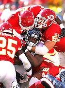 KANSAS CITY, MO - SEPTEMBER 26:  Running back Domanick Davis #37 of the Houston Texans is gang tackled by safety Greg Wesley #25 and linebacker Scott Fujita #51 of the Kansas City Chiefs at Arrowhead Stadium on September 26, 2004 in Kansas City, Missouri. The Texans defeated the Chiefs 24-21. ©Paul Anthony Spinelli *** Local Caption *** Domanick Davis, Greg Wesley, Scott Fujita