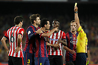 Barcelona´s Sergio Busquets receives a yellow card during 2014-15 Copa del Rey final match between Barcelona and Athletic de Bilbao at Camp Nou stadium in Barcelona, Spain. May 30, 2015. (ALTERPHOTOS/Victor Blanco)