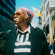 Old woman on the street wearing a colourful headscarf and tinted glasses USA