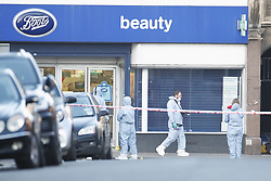 © Licensed to London News Pictures. 03/02/2020. London, UK. Scenes of crime officers gather evidence outside Boots where the assailant was shot in Streatham High Road the day after a man was shot by police after he stabbed two people. Sudesh Amman, who was released from prison recently for terror offences, was under active police surveillance at the time of the attack - which police think was an Islamist-related terrorist incident. Photo credit: Peter Macdiarmid/LNP