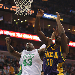 Feb 10, 2010; New Orleans, LA, USA; Boston Celtics center Kendrick Perkins (43) and New Orleans Hornets center Emeka Okafor (50) battle for a rebound during the first quarter at the New Orleans Arena. Mandatory Credit: Derick E. Hingle-US PRESSWIRE