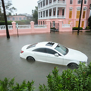 Charleston, SC- A car sits in flood waters in the Battery, a park in historic downtown Charleston, after Hurricane Matthew battered the coastline.