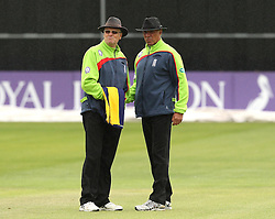 Umpires Steve Garratt and David Millns come together to discuss whether to take the players off during a rain shower - Mandatory by-line: Robbie Stephenson/JMP - 07966386802 - 04/08/2015 - SPORT - CRICKET - Bristol,England - County Ground - Gloucestershire v Durham - Royal London One-Day Cup