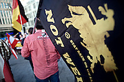 Frankfurt am Main | 21 Apr 2015<br /> <br /> Am Dienstag (21.04.2015) hielt die rassistische und islamfeindliche Gruppe PEGIDA (Patriotische Europ&auml;er gegen die Islamisierung des Abendlandes) an der Hauotwache neben der Katharinenkirche in Frankfurt am Main eine Mahnwache unter dem Motto &quot;Wir sind wieder da&quot; ab. Die Kundgebung war wie immer mit Hamburger Gittern abgesperrt und von starken Polizeikr&auml;ften bewacht. Etwa 1000 Menschen nahmen an den Gegenprotesten teil.<br /> Hier: Ein PEGIDA-Aktivist mit einer Fahne mit der Aufschrift &quot;Islamists not welcome - stay backor we'll kick you back&quot; und einem Logo &quot;Identit&auml;re Bewegung&quot;.<br /> <br /> &copy;peter-juelich.com<br /> <br /> [Foto Honorarpflichtig | No Model Release | No Property Release]